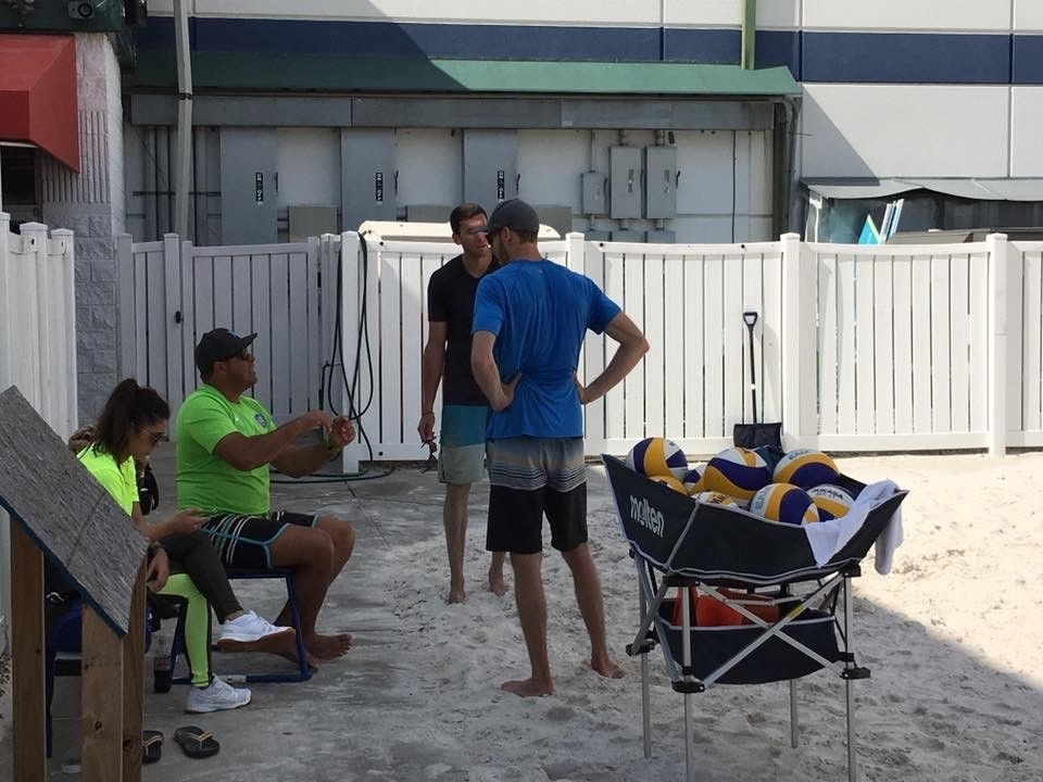 Paulao coaching Ariel and Sean in Florida. Credit: André Brito
