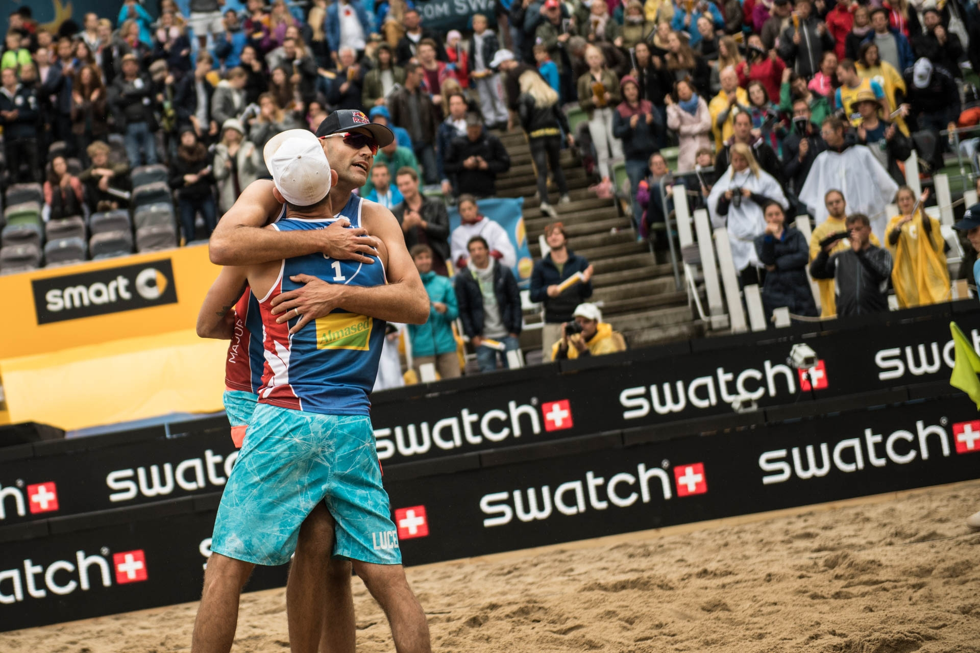 Phil and Nick celebrate after winning gold. Photocredit: Joerg Mitter.
