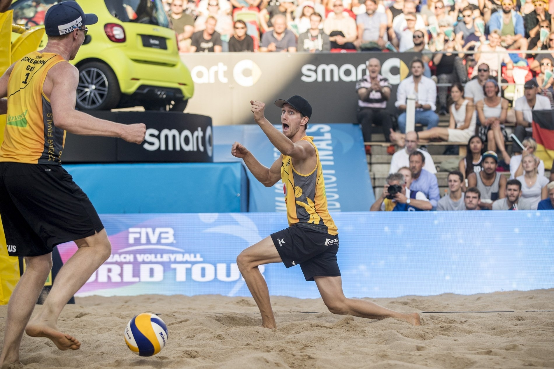 Lorenz and Markus celebrate after their big win on the Red Bull Beach Arena