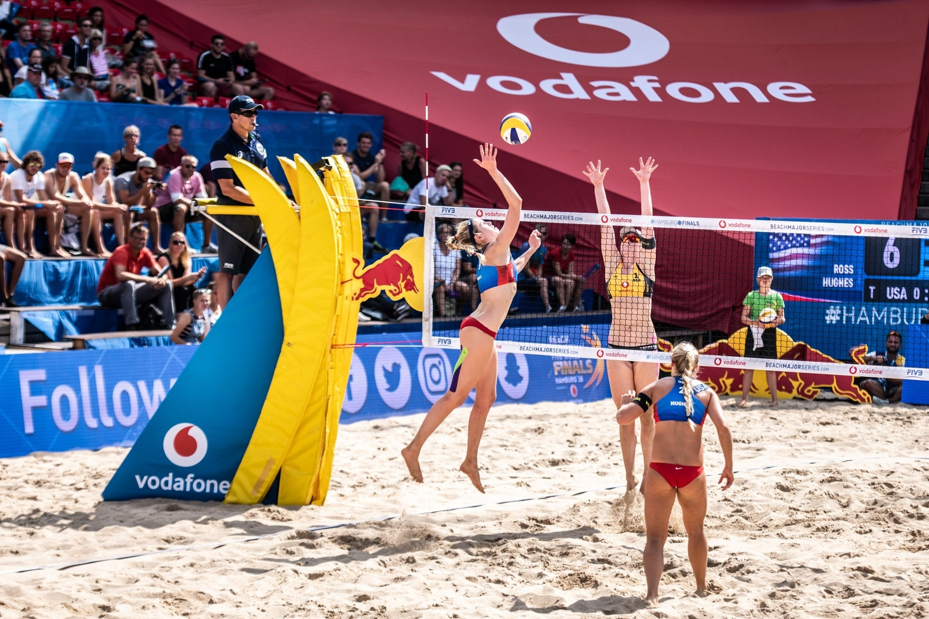 Summer and Sara (in blue) battle towards victory on the Red Bull Beach Arena
