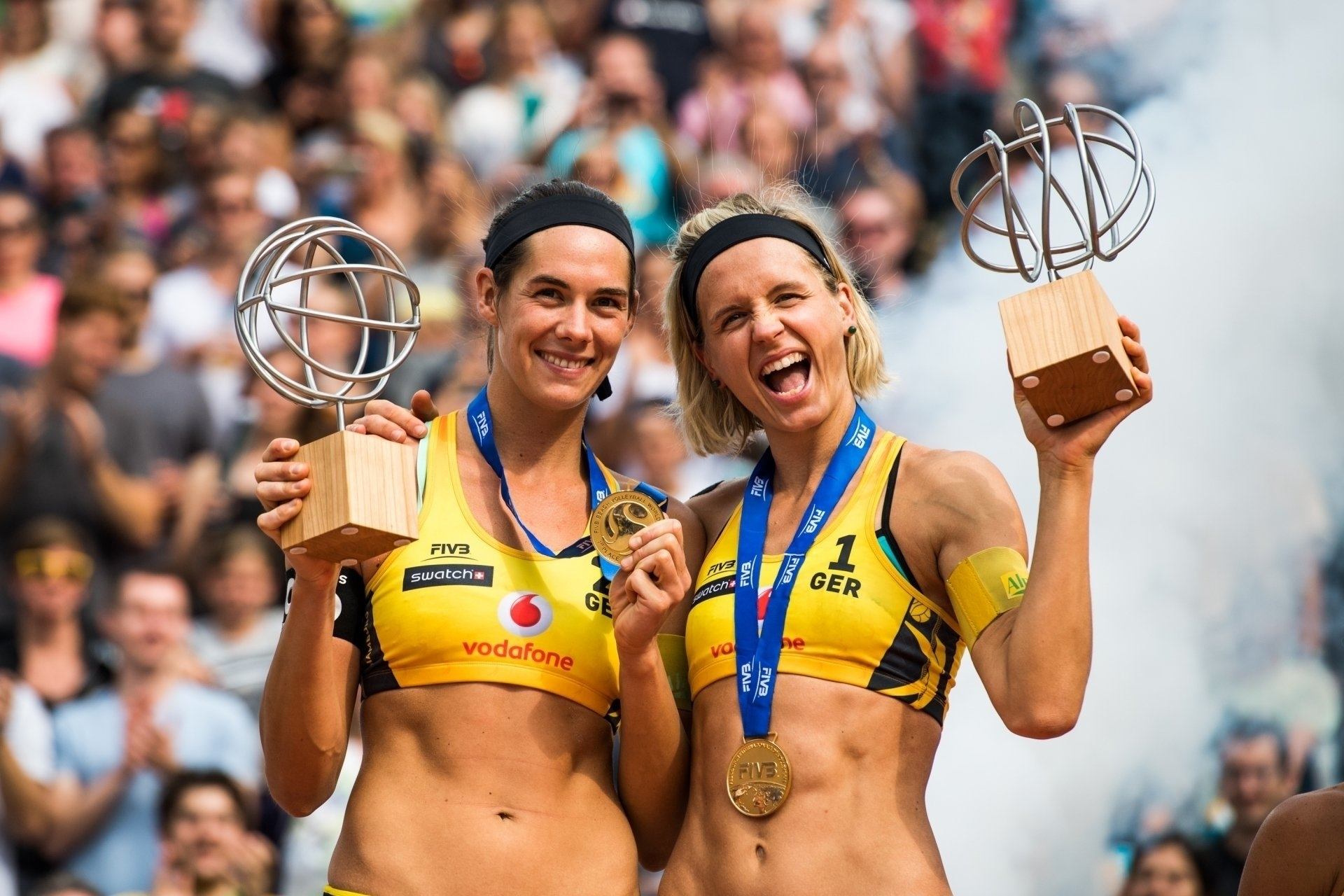 Kira (left) and Laura celebrate their World Tour Finals title last year